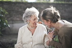 Adult woman beside her mother with dementia
